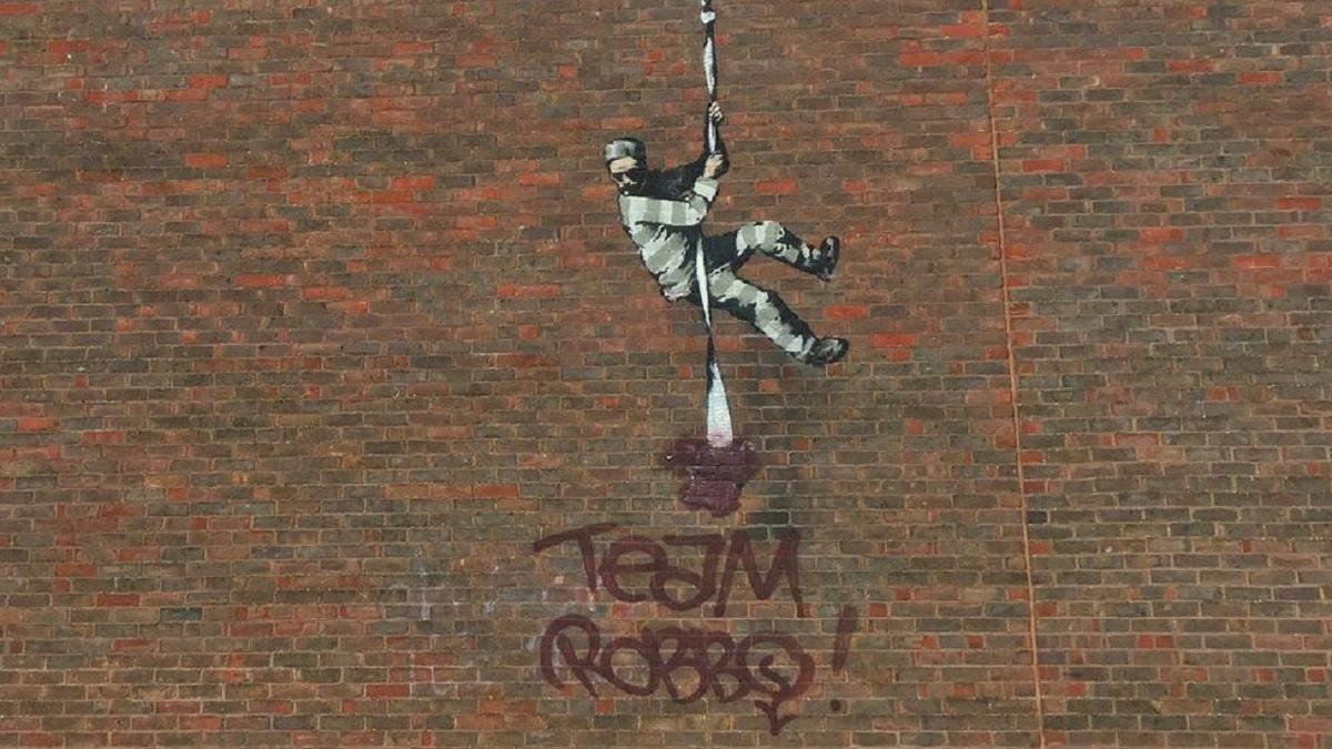 Испорченное граффити Бэнкси